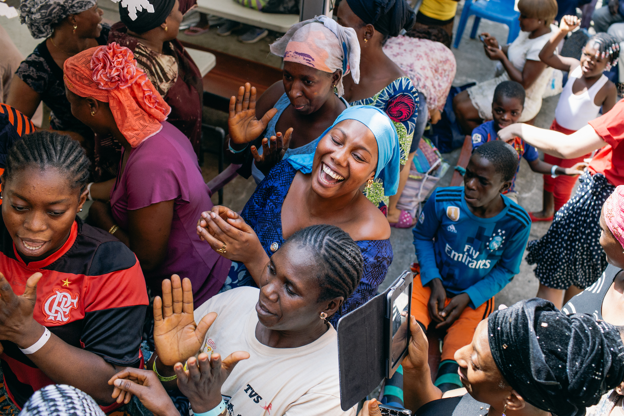 Image: Mercy Ships patients celebrate with singing and dancing after having received Christmas gifts.