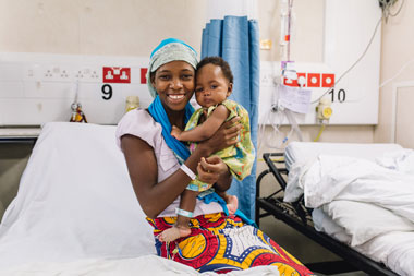 Hassanatou holding Aissata after her surgery on the Africa Mercy